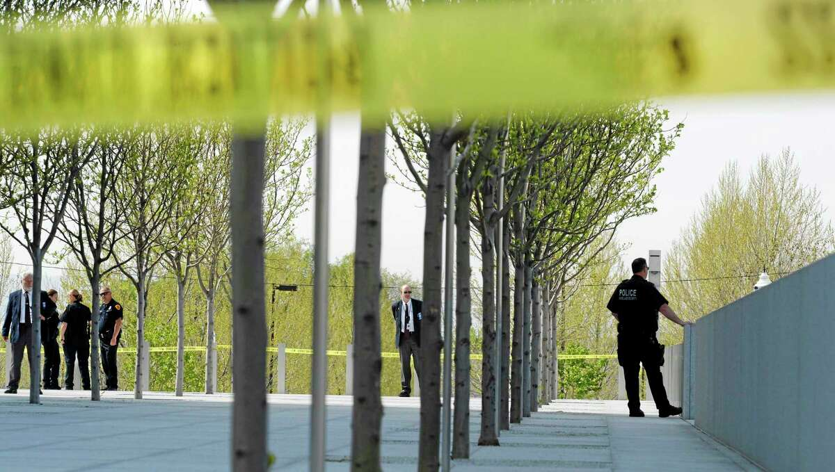 Authorities secure the plaza as police investigate a shooting inside the Federal Courthouse, Monday, April 21, 2014, in Salt Lake City. A U.S. marshal shot and critically wounded a defendant on Monday in a new federal courthouse after the man rushed the witness stand with a pen at his trial in Salt Lake City, authorities said. (AP Photo/The Salt Lake Tribune, Steve Griffin) DESERET NEWS OUT; LOCAL TV OUT; MAGS OUT