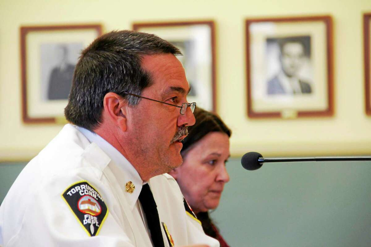 Torrington Fire Chief Gary Brunoli addresses the City Council on Monday, April 21, 2014, during a special council meeting regarding budgets at City Hall. Brunoli's $4.8 million budget adds seven firefighters to his department, which has about 53 members. Esteban L. Hernandez Register Citizen