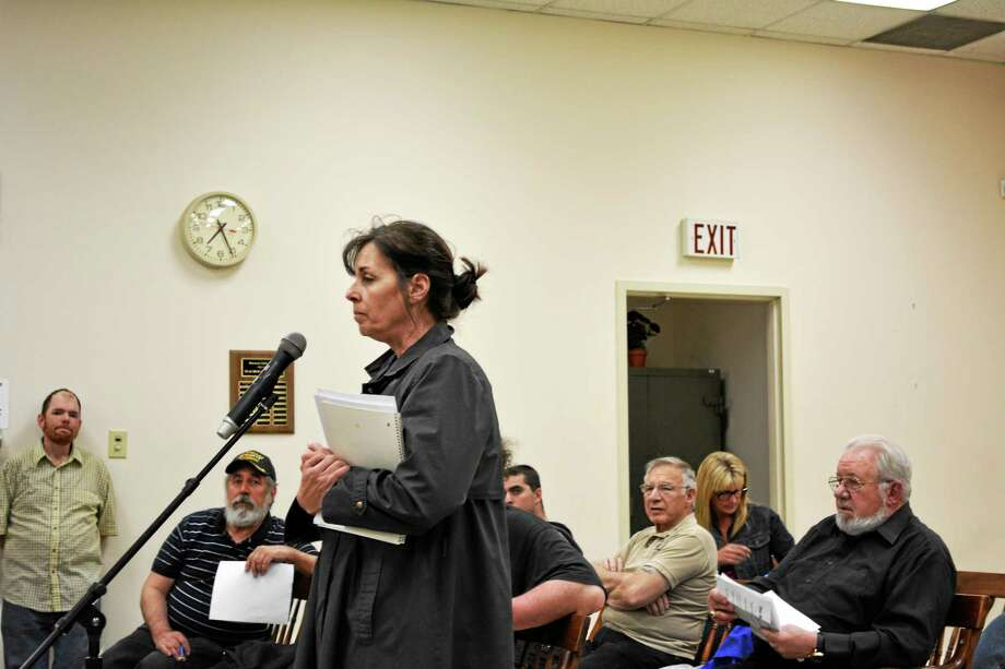 Karen Beadle, chairman of the Charter Revision Committee, addresses the Board of Selectmen Monday night. Photo: Ryan Flynn - Register Citizen