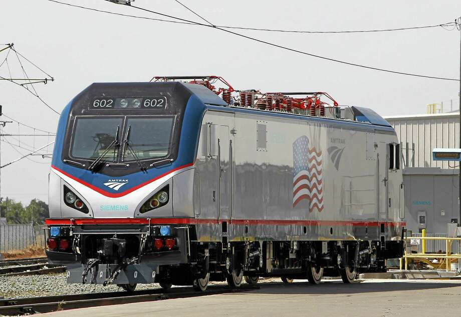 In this photo taken Saturday, May 11, 2013, is one of the new Amtrak Cities Sprinter Locomotives built by Siemens Rails Systems in Sacramento, Calif.  The new electric locomotive will run on the Northeast intercity rail lines and  replace Amtrak locomotives that have been in service for 20 to 30 years. (AP Photo/Rich Pedroncelli) Photo: AP / AP