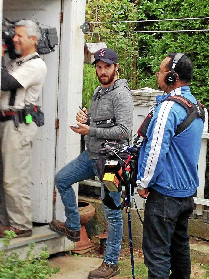 Elias Orelup, facing camera, directs an episode of 'American Pickers.' Photo: Contributed Photo