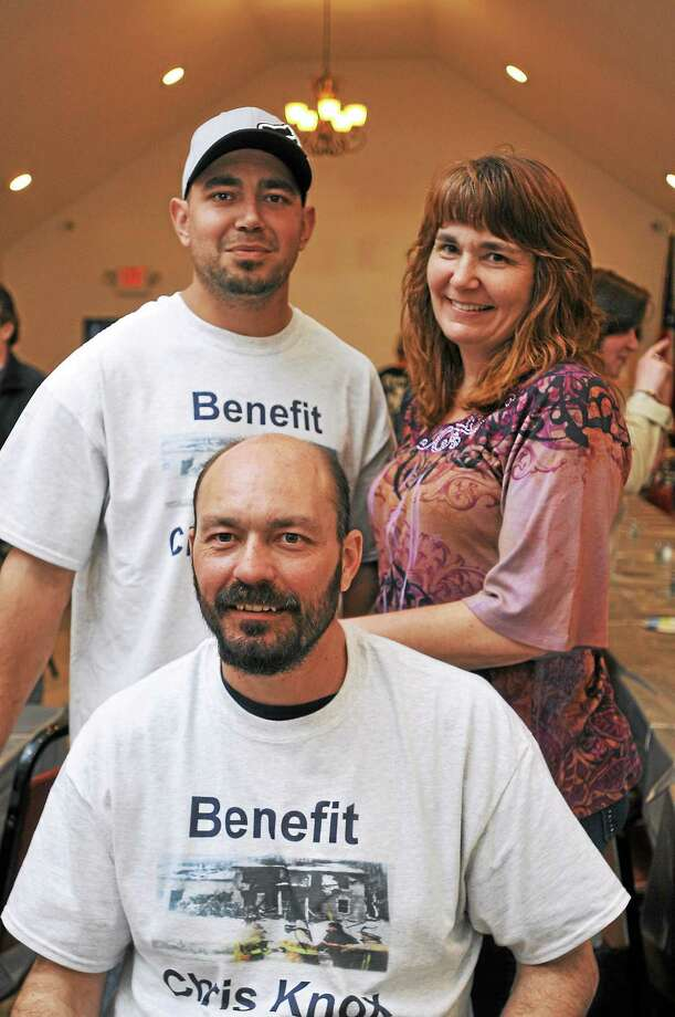 Christopher Knox, front, with Russell Melius and Deanne Knox Fredsall during a fundraiser for Knox Saturday at the Winsted VFW Post 296. Photo: Laurie Gaboardi — Register Citizen