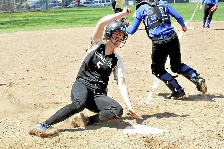 Thomaston's Abby Hurlbert slides into home during the Golden Bears' 14-0 victory against Lewis Mills on Saturday. Photo: Laurie Gaboardi — Register Citizen