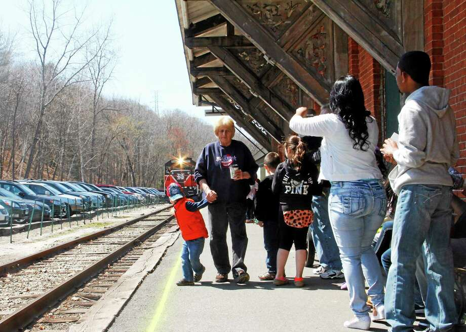 A boy turns to see the approaching Easter Bunny Express Train at the Railroad Museum of New England and the Naugatuck Railroad in Thomaston on Saturday, April 19, 2014. Photo: Esteban L. Hernandez — Register Citizen