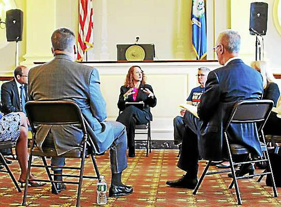 U.S. Rep. Elizabeth Esty addresses mental health, medical and law enforcement professionals from around the state in Waterbury City Hall Thursday during a discussion on the stateís rising heroin problem. Lindsay Boyle ó Special to The Register Citizen Photo: Journal Register Co.