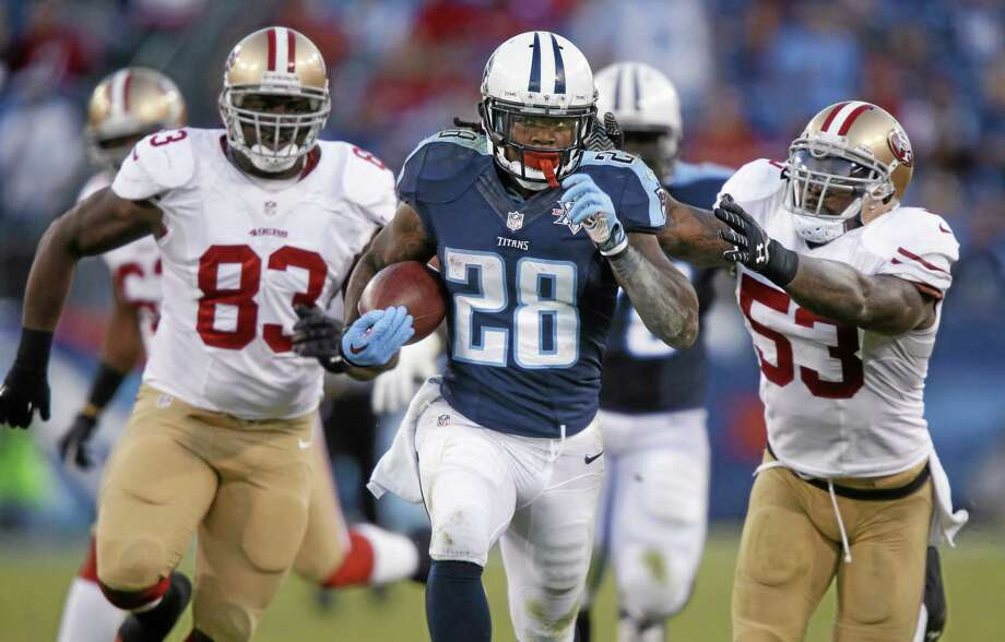 Former Tennessee Titans running back Chris Johnson said Thursday he has no concerns about his surgically repaired knee or how the New York Jets will split carries in the backfield. Photo: Wade Payne — The Associated Press File Photo  / FR23601 AP