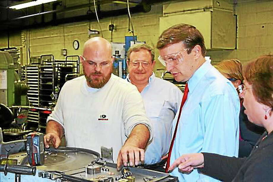 Ryan Flynn - Register CitizenPress Tech Robert Czekierda (left) shows Sen. Chris Murphy a step in the sintering process. Photo: Journal Register Co.