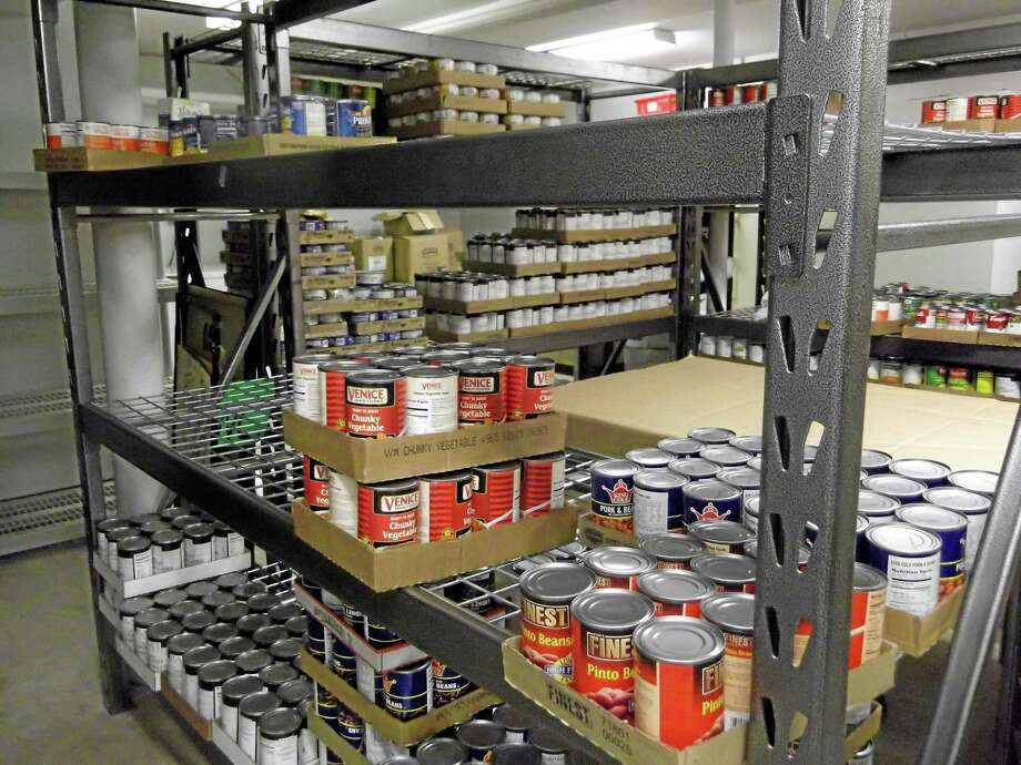 The basement at FISH, a social services organization in Torrington, is usually fully stocked with food including peanut butter, soups and pasta sauces. Photo: Register Citizen File Photo