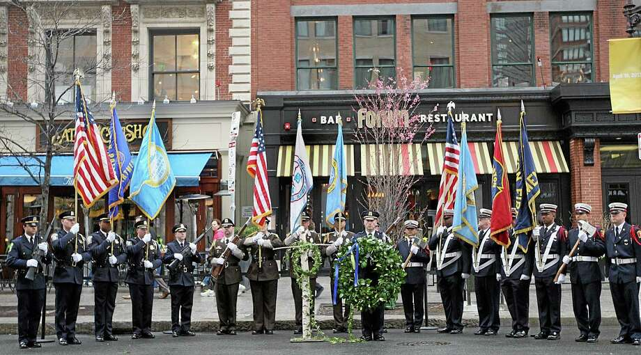 Honor Guard members line up in front of the Forum Restaurant in Copley Square, where a wreath laying ceremony was held to commemorate the one year anniversary of the Boston Marathon bombings, Tuesday, April 15, 2014. Photo: Wendy Maeda — The Boston Globe — The Associated Press  / The Boston Globe