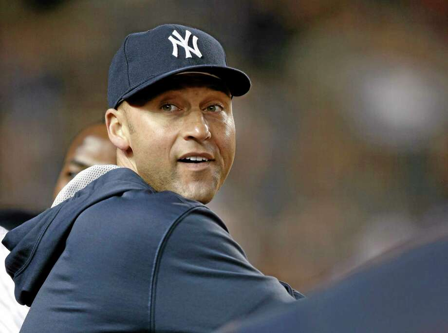 Derek Jeter and the New York Yankees will be idle again on Tuesday after rain washed out the first game of a two-game series with the visiting Chicago Cubs. There will be a day-night doubleheader on Wednesday in the Bronx. Photo: Kathy Willens — The Associated Press  / AP