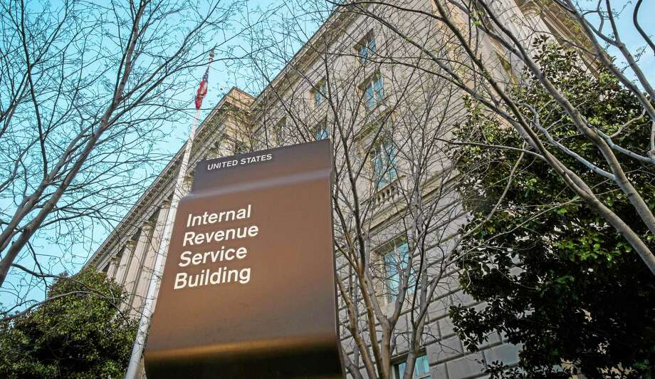 The Internal Revenue Service Headquarters (IRS) building is seen Sunday in Washington. The Internal Revenue Service already has received nearly 100 million tax returns, but anticipates getting about 35 million more by the midnight Tuesday deadline. Many other taxpayers, however, are opting for plan B and asking for more time to file. Photo: Associated Press  / AP