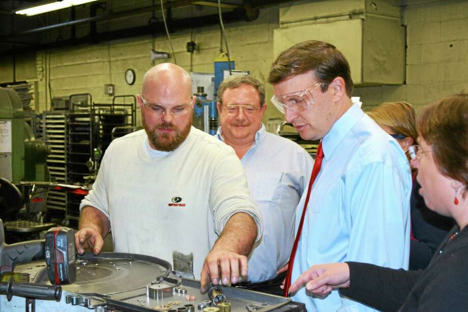 Ryan Flynn - Register CitizenPress Tech Robert Czekierda (left) shows Sen. Chris Murphy a step in the sintering process. Photo: Journal Register Co.