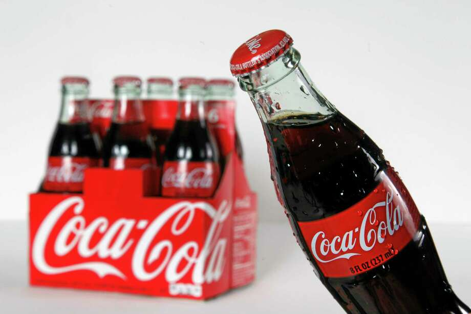 This Oct. 15, 2012, photo shows eight ounce bottles of Coca Cola arranged for a photo in Surfside, Fla.  (AP Photo/Wilfredo Lee) Photo: AP / AP