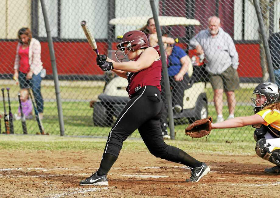 Torrington's Alexa Potter hits her grand slam in the Red Raiders 15-0 win over Holy Cross. Photo: Marianne Killackey — Special To The Register Citizen  / 2013