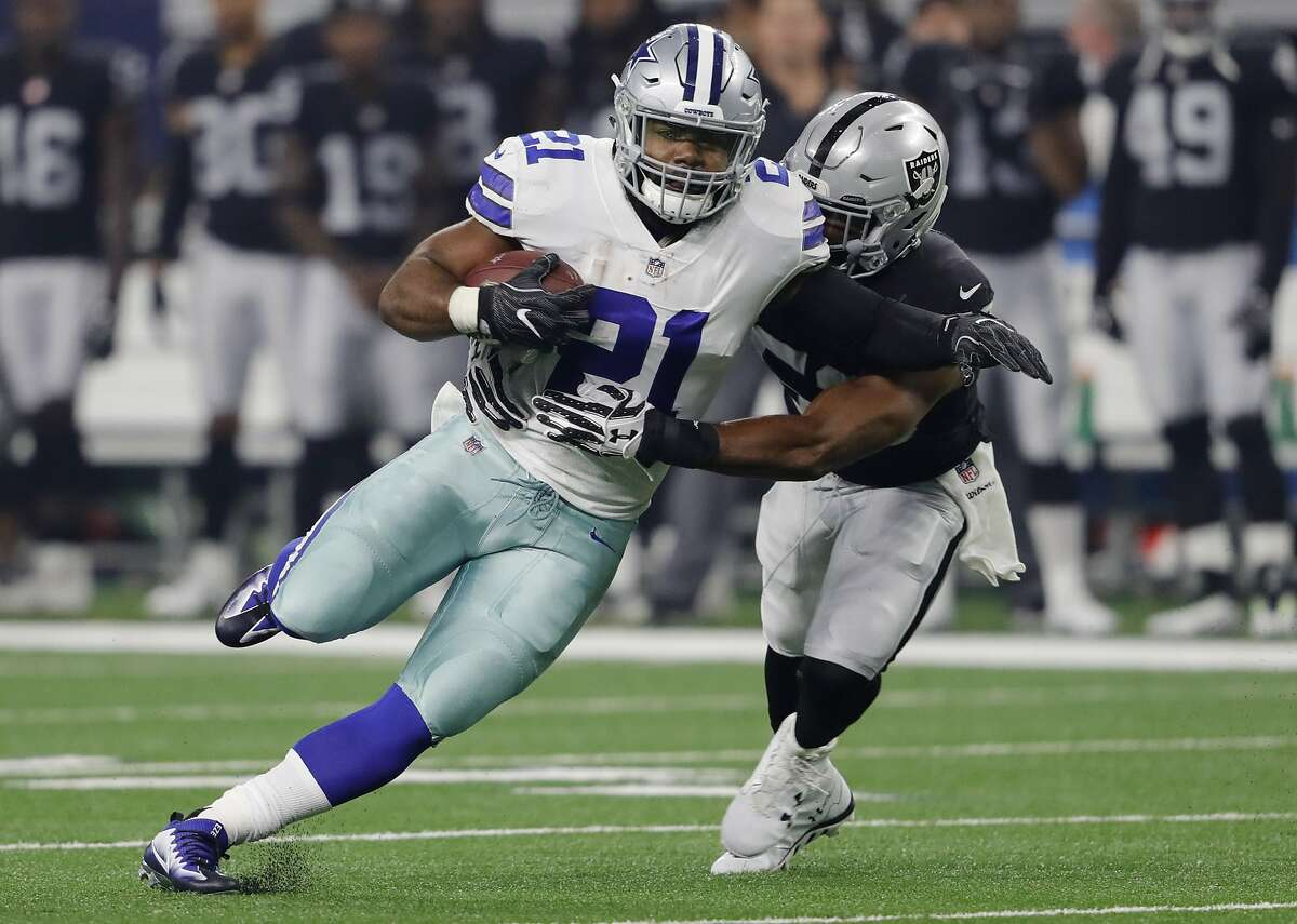 Dallas Cowboys running back Ezekiel Elliott (21) runs against Oakland Raiders linebacker Jelani Jenkins (53) in the first quarter at AT&T Stadium in Arlington, Texas, on Saturday, Aug. 26, 2017. (Rodger Mallison/Fort Worth Star-Telegram/TNS)