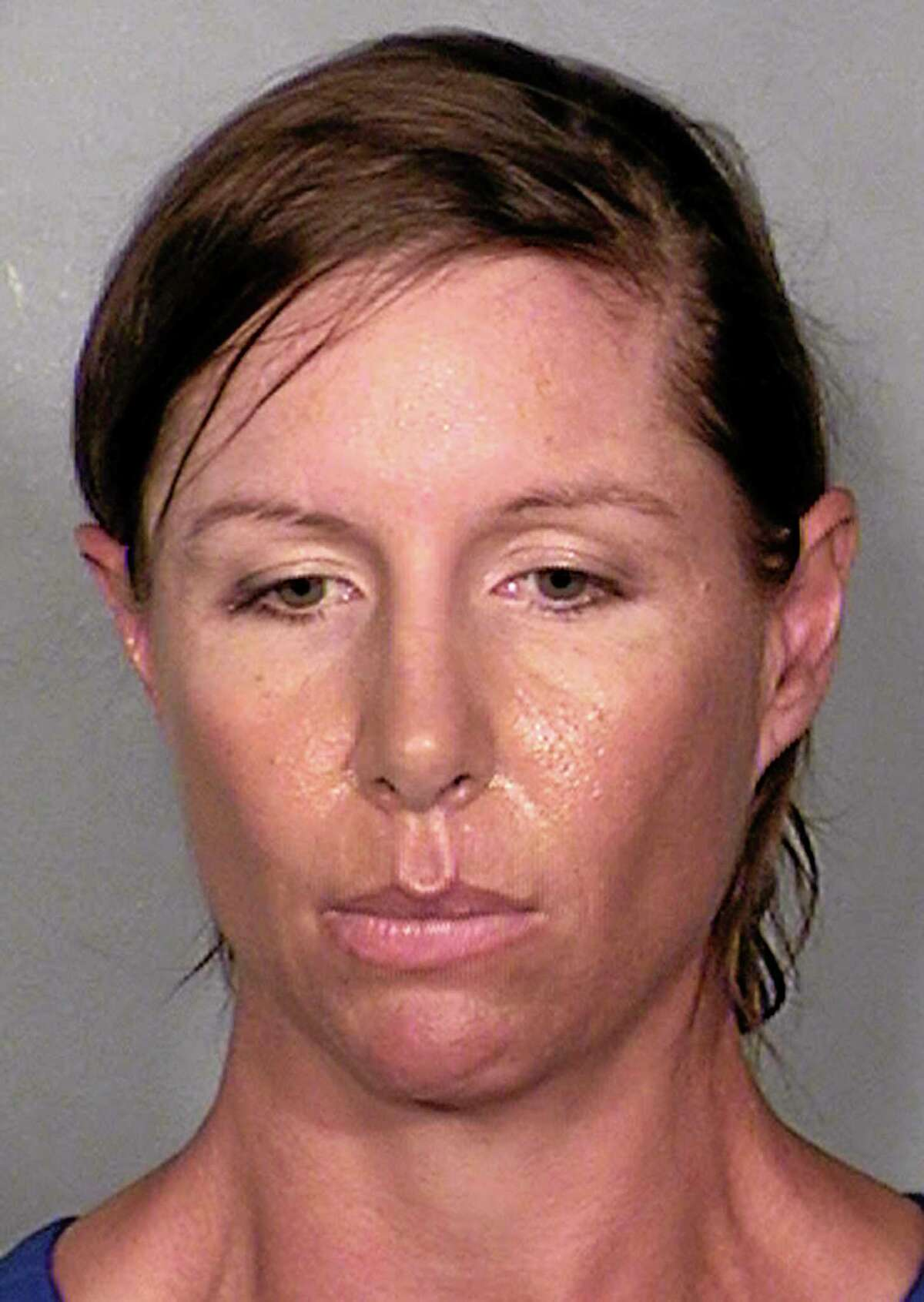 This image provided by the Las Vegas Metropolitan Police Department shows Alison Ernst, who was arrested April 10, 2014 in connection with an incident involving throwing a shoe at Former Secretary of State and Former First Lady Hillary Clinton. Alison was arrested for Disorderly Conduct and released. (AP Photo/Las Vegas Metropolitan Police Department)
