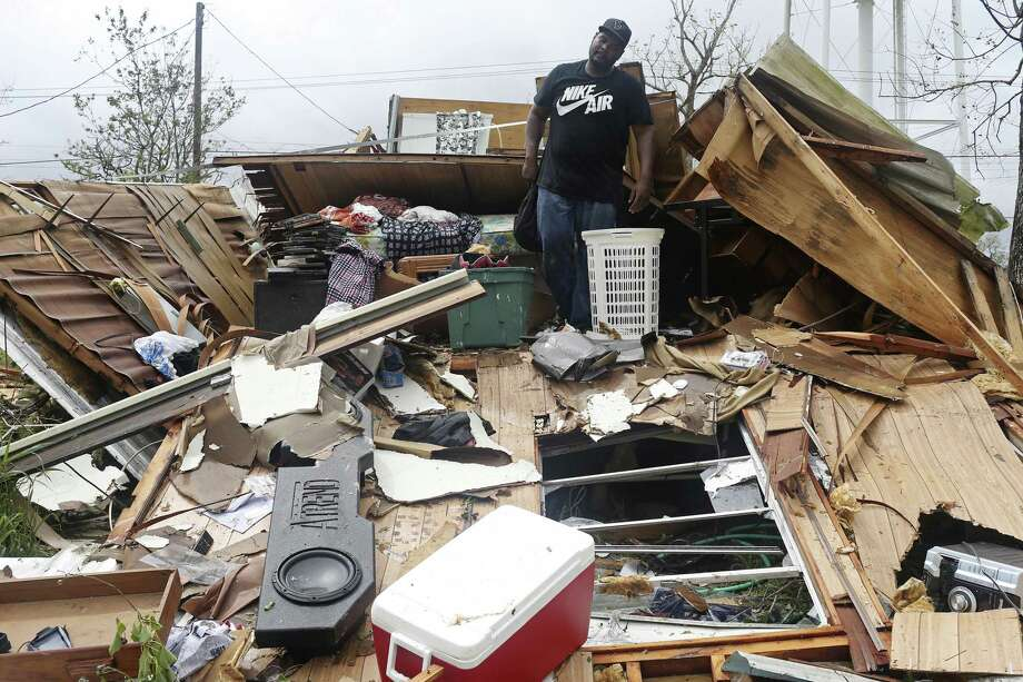 Jeremy Lewis, 30, looks for personal belongings in the debris of his mother's mobile home in Refugio, Texas, Sunday, August 27, 2017. The family evacuated to McAllen before the category four hurricane hit the area Friday night. The family returned on Sunday to find home destroyed and his girlfriend's second floor apartment unit with water damage from a torn roof. Photo: Photos By Jerry Lara / San Antonio Express-News / San Antonio Express-News