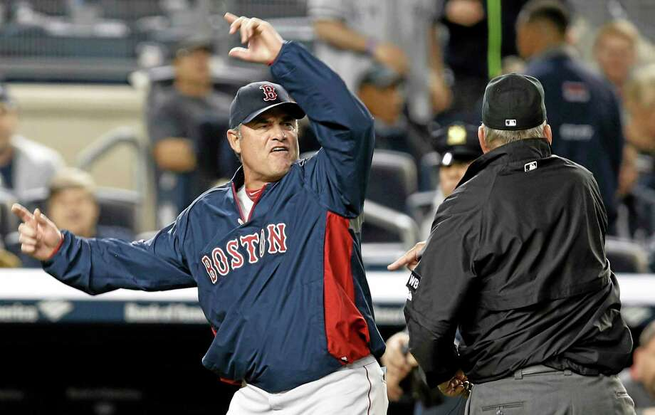 Red Sox manager John Farrell gestures after he was ejected by first base umpire Bob Davidson after Farrell objected to MLB's ruling of an overturned, fourth-inning, force out at first base. The Yankees' Brian McCann scored on the play. Photo: Kathy Willens — The Associated Press  / AP