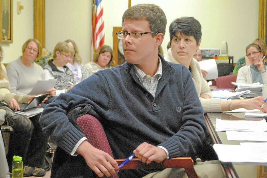 Torrington School Board Budget Committee member Christopher Rovero sits in front of schools superintendent Cheryl Klozcko and a large crowd of audience members. Photo: Register Citizen File Photo