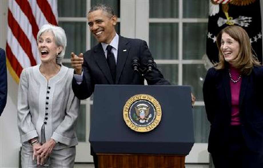 President Barack Obama, flanked by outgoing Health and Human Services Secretary Kathleen Sebelius, left, and his nominee to replace Sebelius, current Budget director Sylvia Mathews Burwell, right,  shares a laugh in the Rose Garden of the White House in Washington, Friday, April 11, 2014, where he made the announcement. (AP Photo/Susan Walsh) Photo: AP / AP