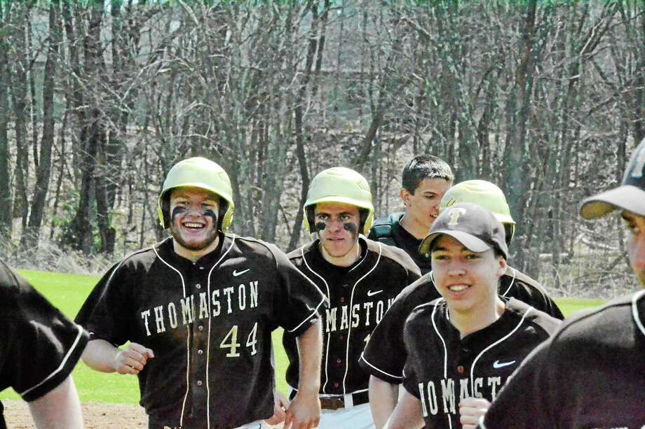 Thomaston's Jake Tehan is all smiles after, being mobbed by his teammates after laying down the game-winning squeeze bunt scoring Mike Milius in the bottom of the seventh the defeat Housatonic, 3-2. Photo: Pete Paguaga — Register Citizen