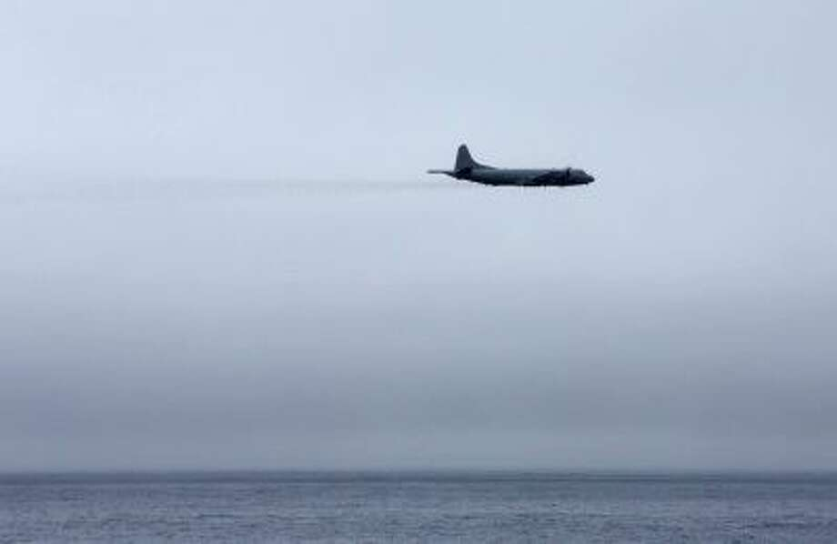 An AP-3C Orion aircraft conducts an aerial search during the operation to locate evidence of the missing Malaysia Airlines Flight MH370. Photo: LSIS James Whittle / © Commonwealth of Australia, Department of Defence