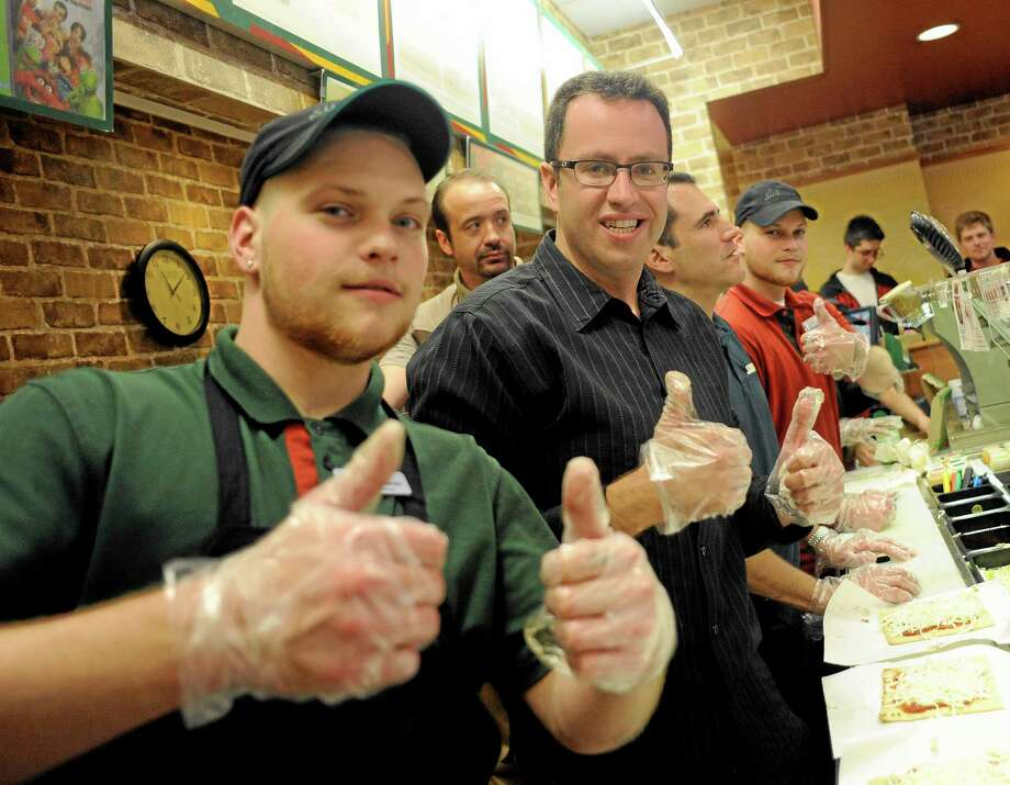 A sandwich artist poses for a photo with Jared 'The Subway Guy' Fogle during March Madness recently. , Photo: (Photo By Matt Strasen/Invision For SUBWAY/AP Images)  / Invision