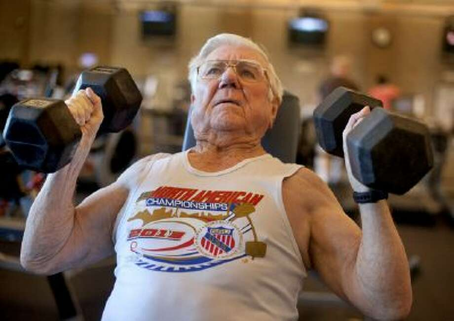 John Gilmour, 92, of Morgan Hill, works out at the Mt. Madonna YMCA in Morgan Hill, Friday, March 28, 2014. Gilmour started to get into competitive weight lifting in the past few years.  (Patrick Tehan/Bay Area News Group) Photo: Patrick Tehan / San Jose Mercury News