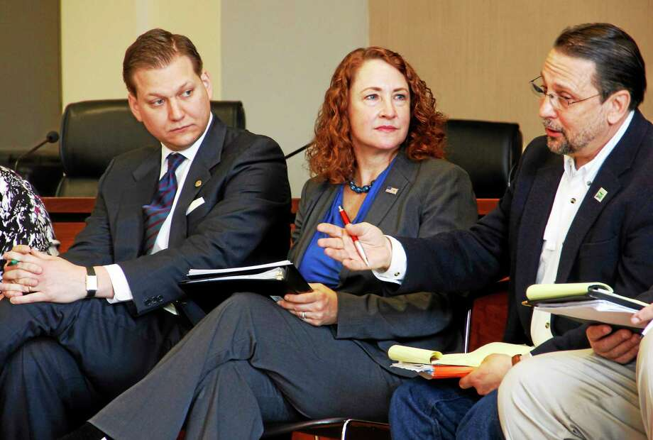 From left: Bryan P. Hurlburt, State Executive Director from the Farm Service Agency, U.S. Rep. Elizabeth Esty, D-5, and Steven Reviczky, Connecticut's Department of Agriculture Commissioner, sit during a farm bill roundtable discussion organized by Esty's office on Friday, April 11, 2014. About 40 people attended the discussion, which centered around the bill's impact on local farmers. Photo: Esteban L. Hernandez — Register Citizen