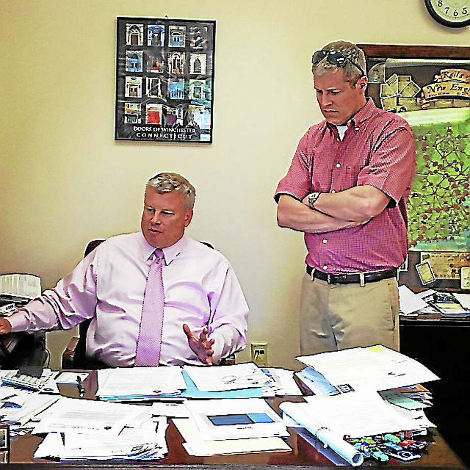 Winchester Public Works Director Neil Amwake, right, speaks with Town Manager Dale Martin in August 2013. Photo: Register Citizen File Photo