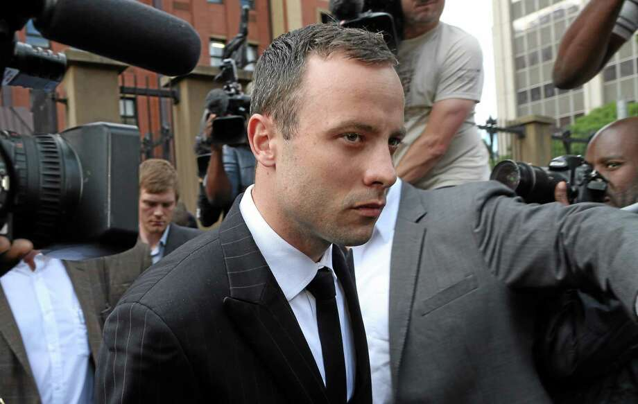 Oscar Pistorius leaves the high court in Pretoria, South Africa, Wednesday, April 9, 2014. Pistorius is charged with murder for shooting dead his girlfriend, Reeva Steenkamp, on Valentines Day in 2013. (AP Photo/Themba Hadebe) Photo: AP / AP