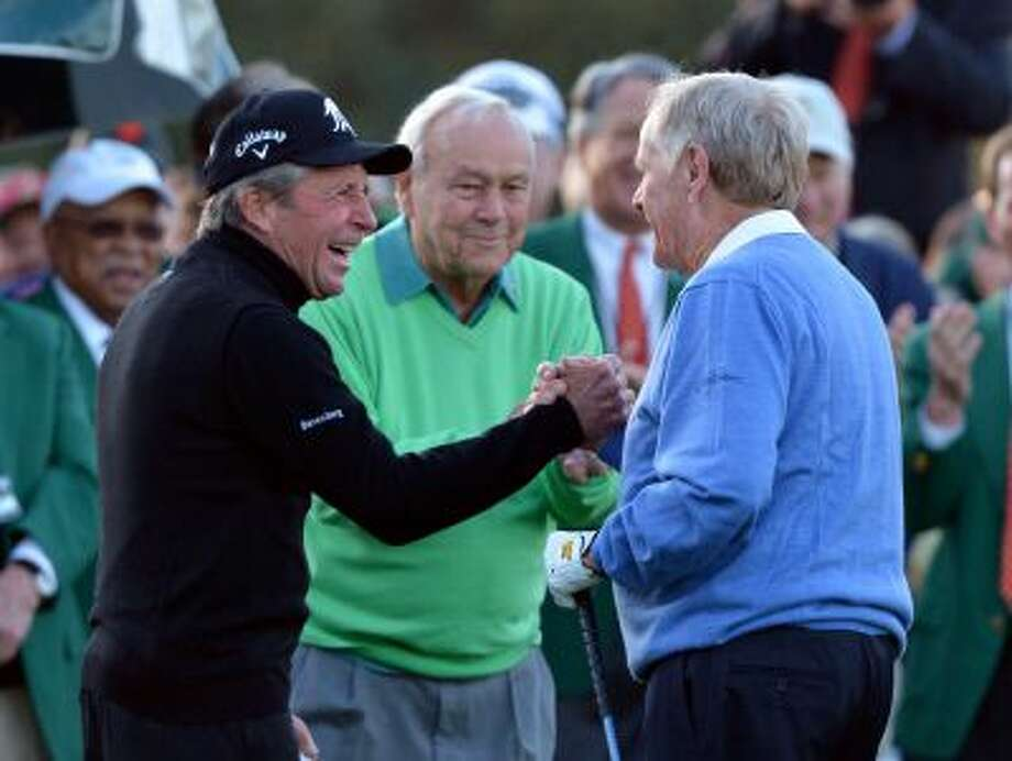 From left, Gary Player, Arnold Palmer and Jack Nicklaus shake hands after hitting ceremonial drives on the first tee during the first round of the Masters golf tournament Thursday, April 10, 2014, in Augusta, Ga. (AP Photo/Atlanta Journal-Constitution, Curtis compton)  MARIETTA DAILY OUT; GWINNETT DAILY POST OUT; LOCAL TV OUT; WXIA-TV OUT; WGCL-TV OUT Photo: AP / Atlanta Journal & Constitution