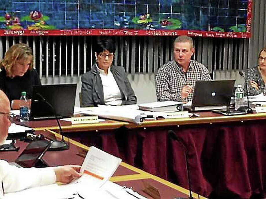 Members of the Torrington Board of Education discuss the districtís proposed budget during a meeting Wednesday. Isaac Avilucea ó Register Citizen Photo: Journal Register Co.