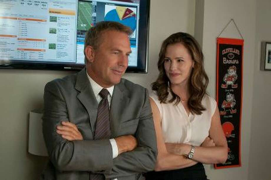 Sonny Weaver Jr. (Kevin Costner) and Ali (Jennifer Garner) in 'Draft Day.' (Dale Robinette/Summit Entertainment) / ©2013 Summit Entertainment, LLC. All rights reserved.
