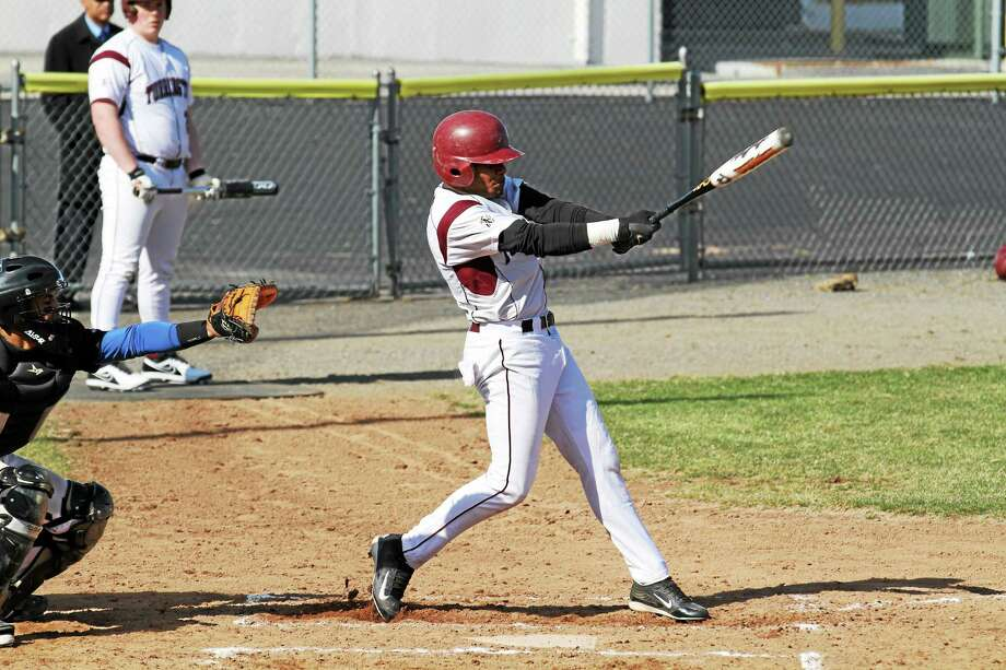 Torrington's Stanley Rijo hits a single in the Red Raiders 28-14 loss to St. Paul. Rijo went 3-for-3 in the loss with a single, double and triple. Photo: Marianne Killackey — Special To The Register Citizen  / 2013