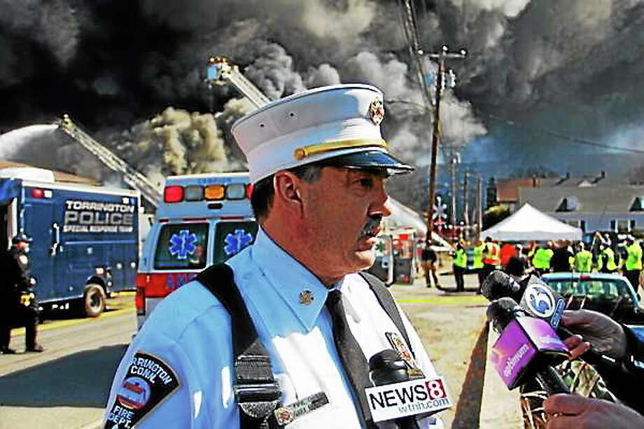 Chief Gary Brunoli talks with reporters as Torrington and dozens of other departments battled a five-alarm blaze at Toce Brothers Inc., a warehouse full of tires, on Albert Street in Torrington on April 3. Esteban L. Hernandez ó The Register Citizen Photo: Journal Register Co.