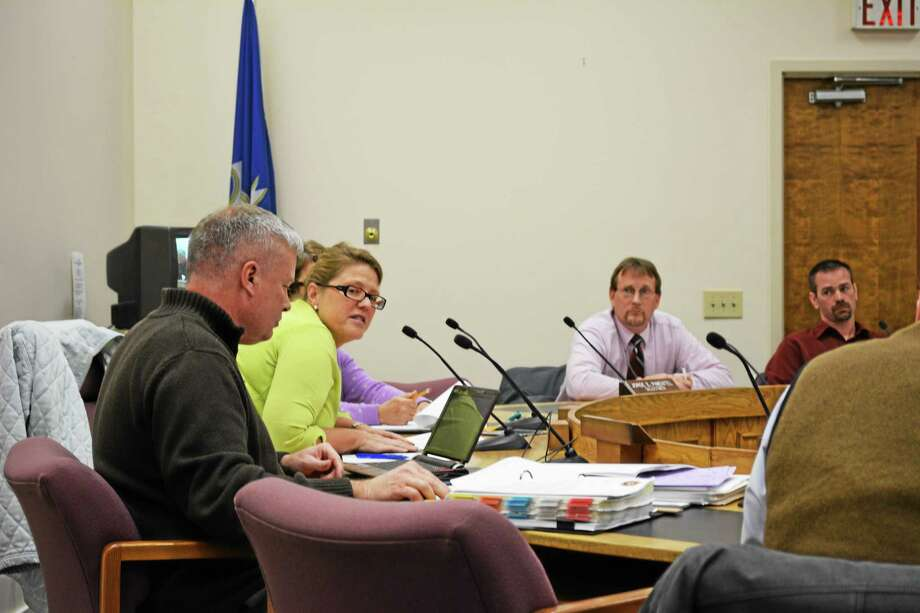 From left: Town Manager Dale Martin, newly minted selectmen Marsha Sterling, Glen Albanesius and selectman Daniel Langer seen at a Board of Selectmen meeting Wednesday. Photo: Ryan Flynn — Register Citizen