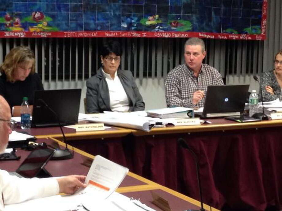 Members of the Torrington Board of Education discuss the district's proposed budget during a meeting Wednesday. Photo: Isaac Avilucea — Register Citizen