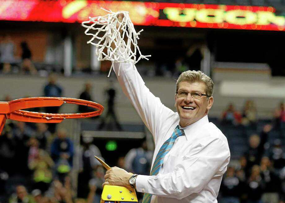 UConn head coach Geno Auriemma holds the ninth national championship net of his career after the Huskies beat Notre Dame 79-58 in a battle of unbeaten teams on Tuesday night in Nashville, Tenn. Photo: John Bazemore — The Associated Press  / AP