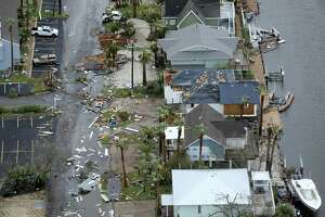 Storm-damaged Rockport, Texas homes are seen in this Sunday, Aug. 27, 2017 aerial photo. Hurricane Harvey made landfall Aug. 25 in Rockport as a Category 4 storm. The economic effect from Harvey alone — likely the costliest U.S. storm ever — is expected to dent U.S. economic growth in the third quarter, though the economic losses likely will be recovered during the following six months as business activity accelerates with rebuilding.