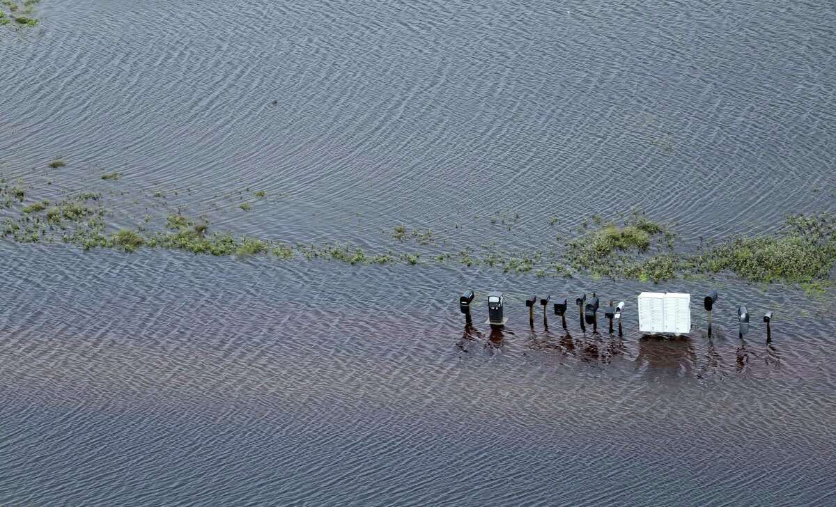 Mailboxes to now-missing homes near Rockport, Texas stand in flood waters Sunday, Aug. 25, 2017 as seen in this aerial photo. Hurricane Harvey made landfall late Friday night in Rockport as a Category 4 storm.
