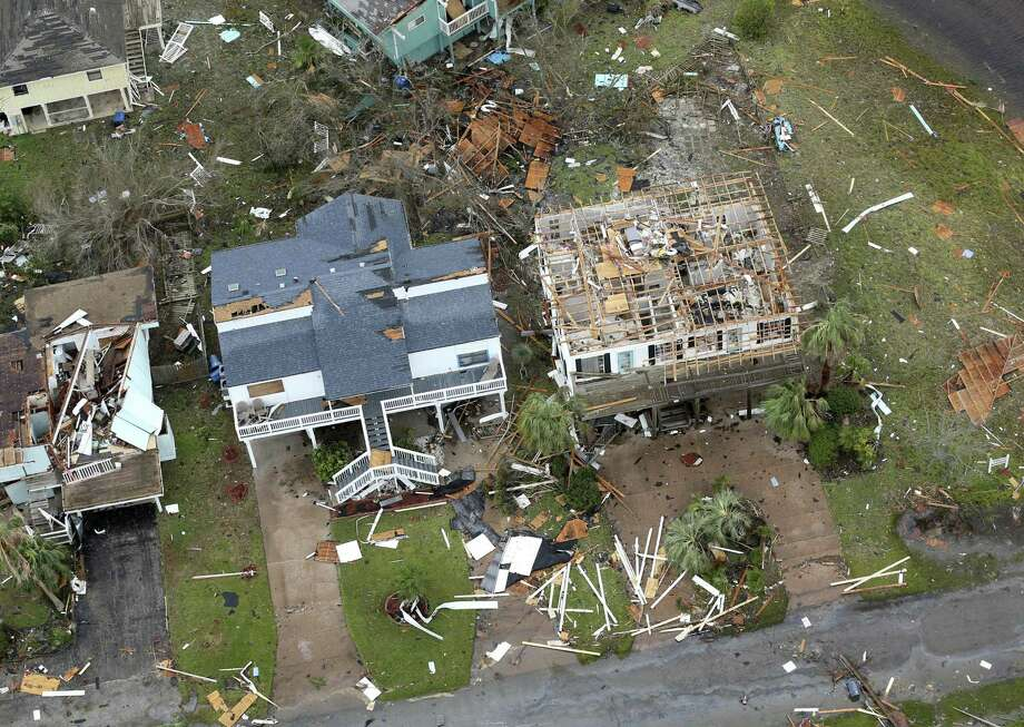 Storm-damaged Rockport, Texas homes are seen in this Sunday, Aug. 25, 2017 aerial photo. Mortgage delinquency rates soared in September and October in many of the coastal and other cities flooded by Harvey, including Houston, Beaumont and Corpus Christi, according to new data from real estate analytics company CoreLogic. Photo: William Luther /San Antonio Express-News / © 2017 San Antonio Express-News