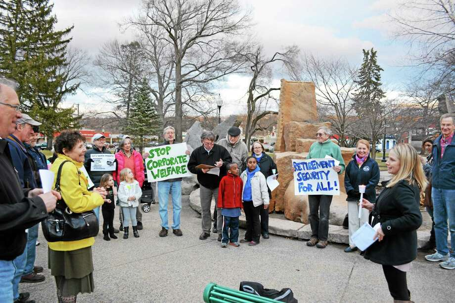 Keri Hoehne (right) led a rally and conversation on income equality at Coe Memorial Park Tuesday night in Torrington. Photo: Ryan Flynn — Register Citizen