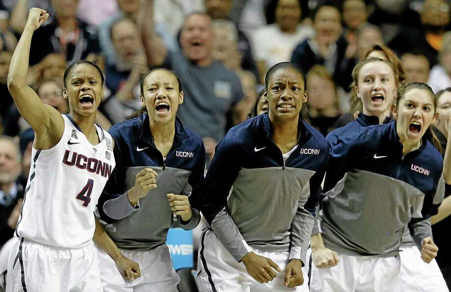 The Connecticut bench cheers a basket against Stanford during the first half of the semifinal game in the Final Four of the NCAA women's college basketball tournament, Sunday, April 6, 2014, in Nashville, Tenn. (AP Photo/Mark Humphrey) Photo: AP / AP