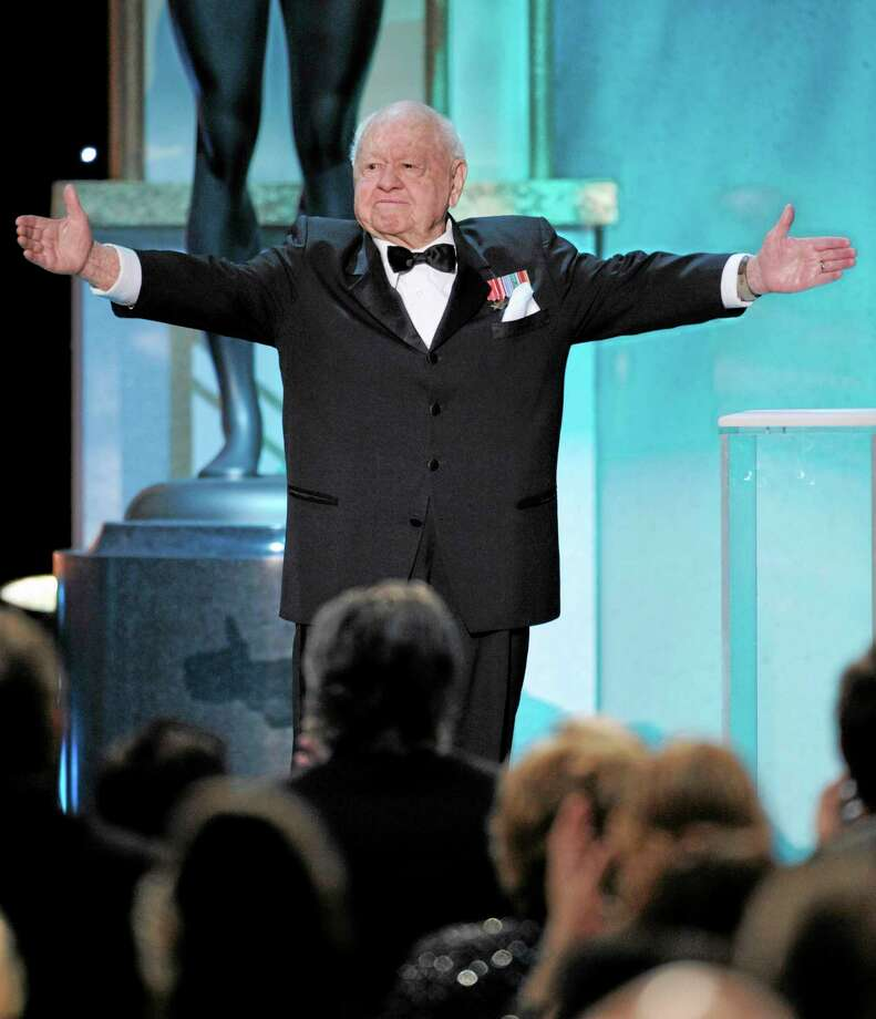 FILE - In this Sunday, Jan. 27, 2008, file photo, Mickey Rooney takes the stage to make an award presentation at the 14th Annual Screen Actors Guild Awards, in Los Angeles. Rooney, a Hollywood legend whose career spanned more than 80 years, has died. He was 93. Los Angeles Police Commander Andrew Smith said that Rooney was with his family when he died Sunday, April 6, 2014, at his North Hollywood home. (AP Photo/Mark J. Terrill, File) Photo: AP / AP