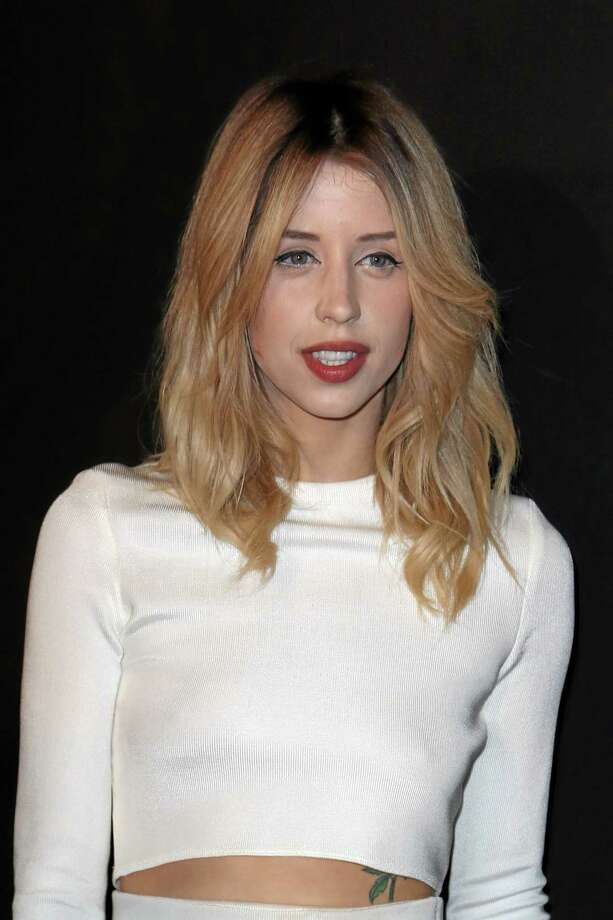 Peaches Geldof arrives to attend the ETAM's ready to wear fall/winter 2014-2015 fashion collection presented in Paris in February 2014. Entertainer Bob Geldof's agent says his 25-year-old daughter Peaches has died. Photo: Associated Press File Photo  / AP