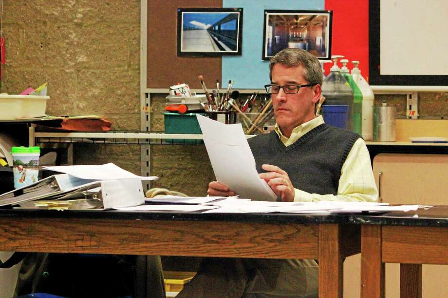 David W. Wilson, vice chair of the Litchfield Board of Finance, looks over the proposed town budget at a meeting Monday. Photo: Shako Liu — The Register Citizen
