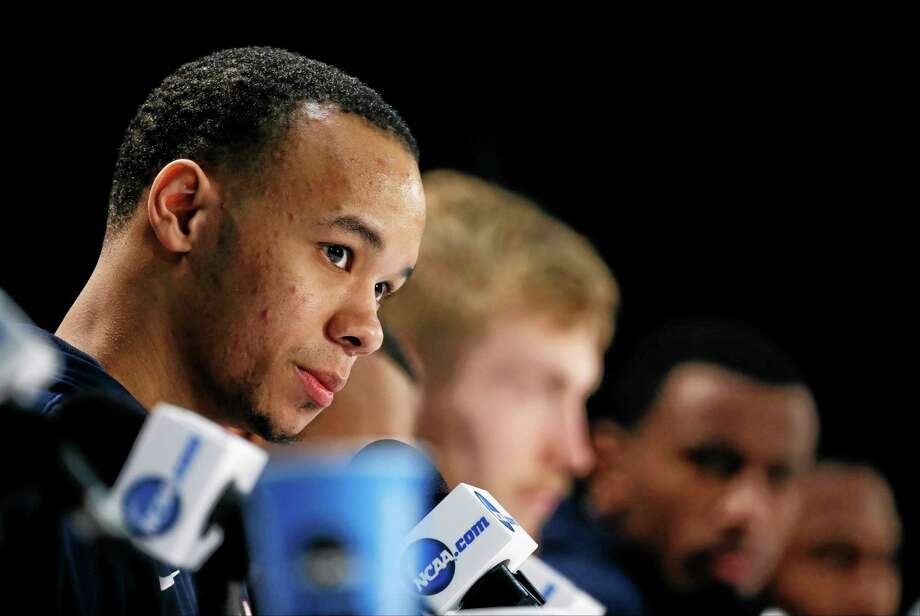 UConn guard Shabazz Napier listens to a question during a news conference Sunday in Arlington, Texas. Photo: David J. Phillip — The Associated Press  / AP