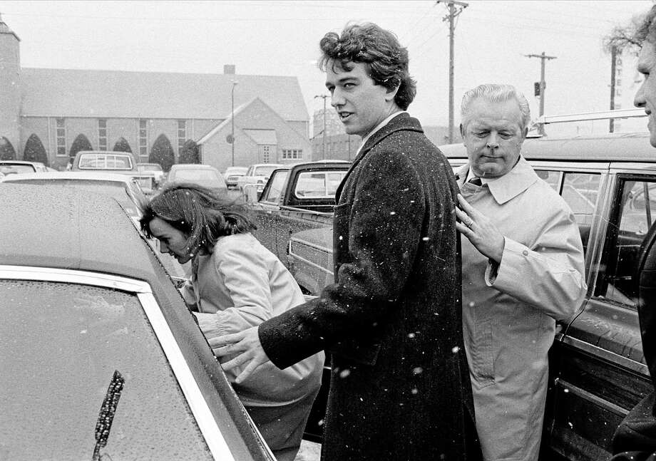 FILE - In this March 17, 1984 file photo, Robert Kennedy Jr. and his wife, Emily, get into a car as they are escorted by private investigator Don Wiley outside the courthouse in Rapid City, S.D. Kennedy received a suspended sentence and two years probation on his guilty plea to a charge of heroin possession. (AP Photo/Mark Elias) Photo: AP / AP