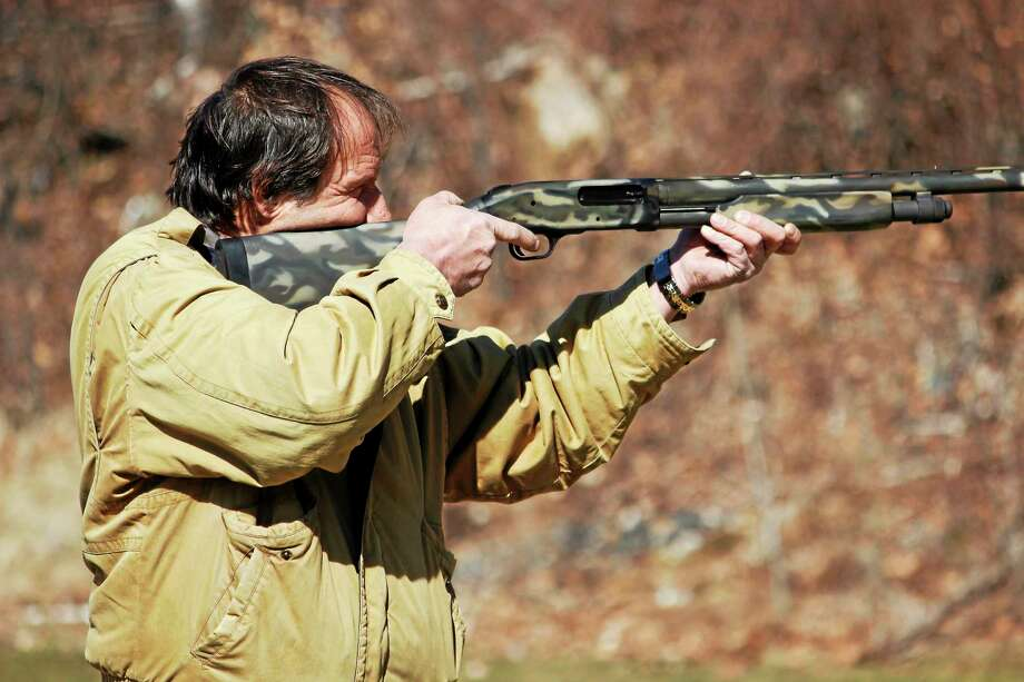 A man was targeting the range in the ham shoot. Photo: Shako Liu-The Register Citizen
